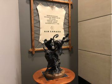 air canada maple leaf lounge calgary bullrider statue