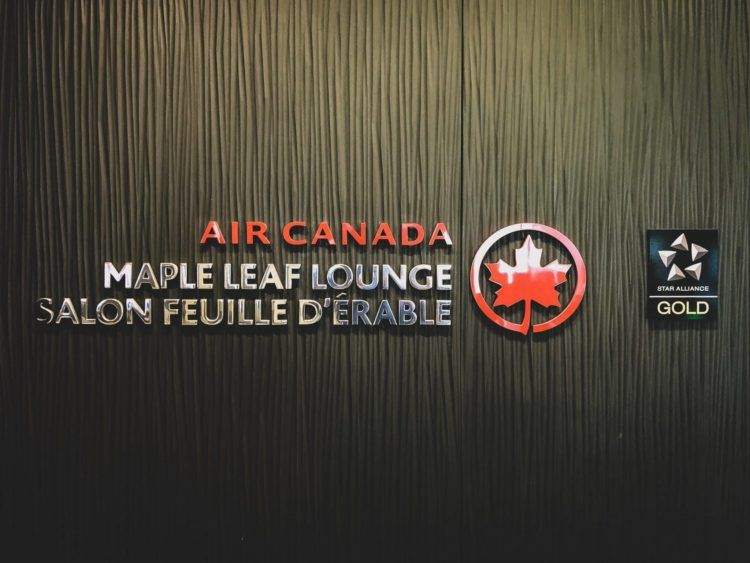air canada maple leaf lounge calgary logo